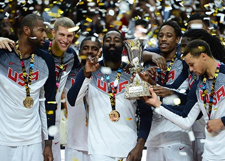 The USA MNT celebrates after winning FIBA Gold.