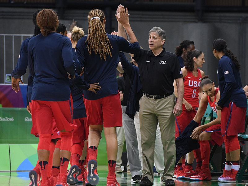 USA assistant coach Doug Bruno gets some high fives from team members.