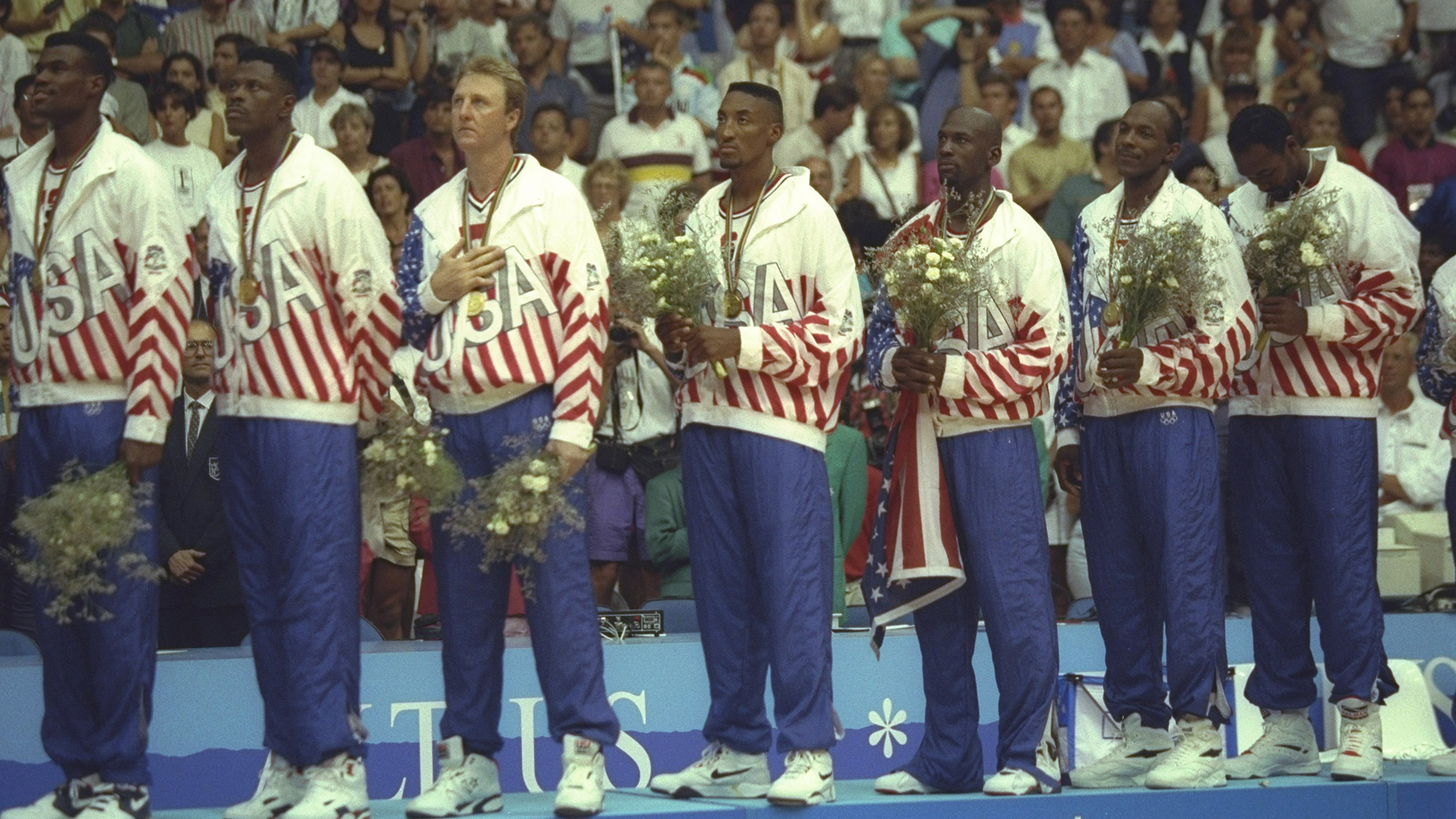 The 'Dream Team' celebrates on the stand after winning the gold medal