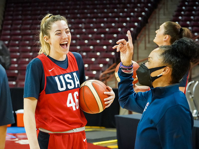 Katie Lou Samuelson cracks up at a joke told by USA head coach Dawn Staley.