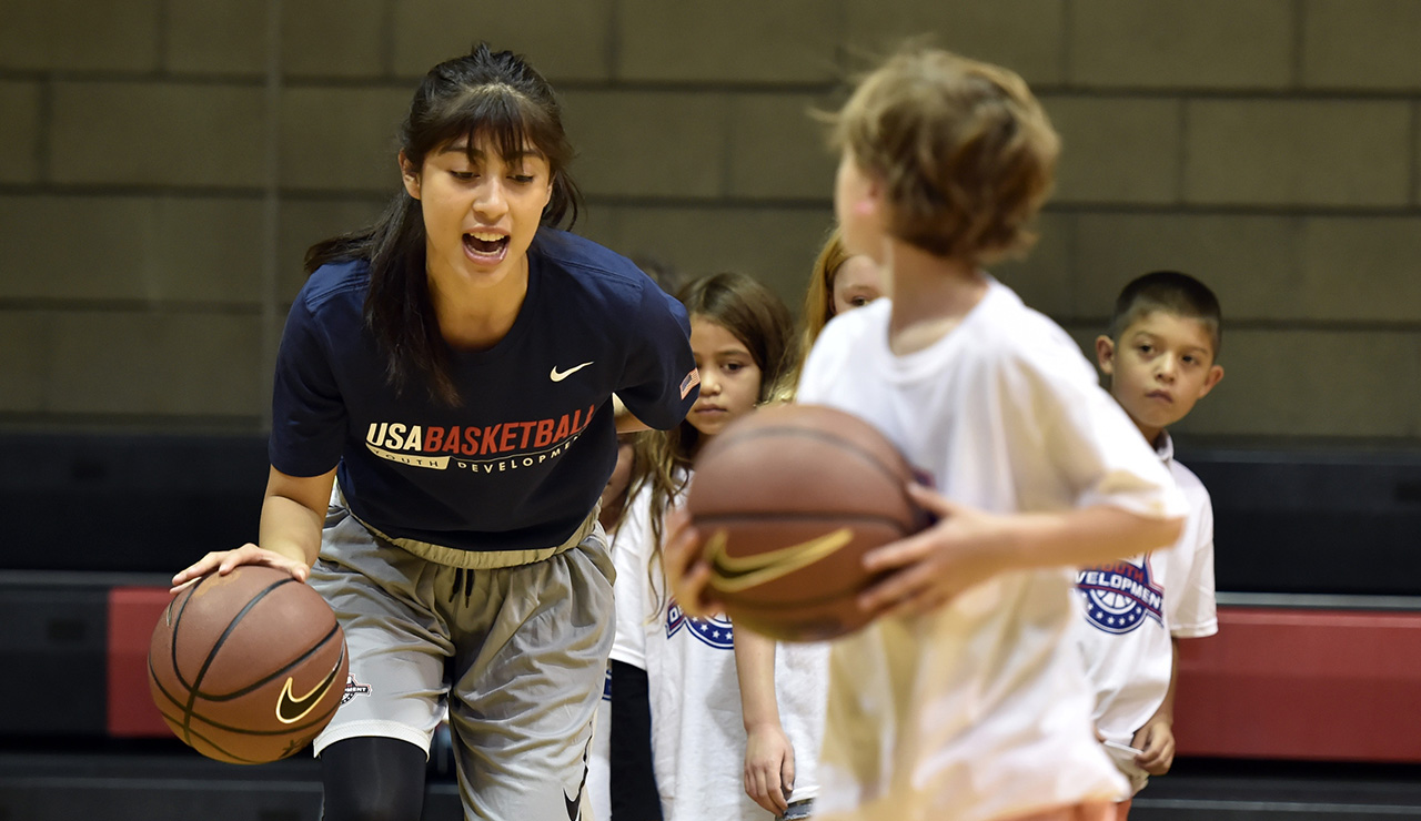 girl dribbling at a USA Basketball clinic