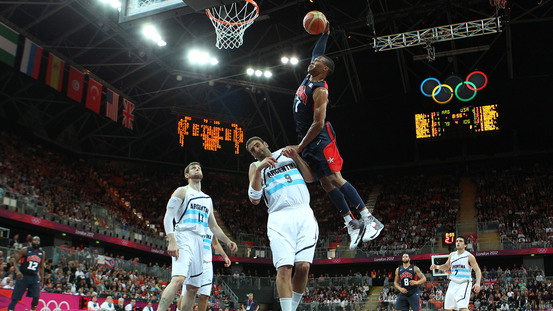 Russell Westbrook of the U.S. dunks over an Argentina player