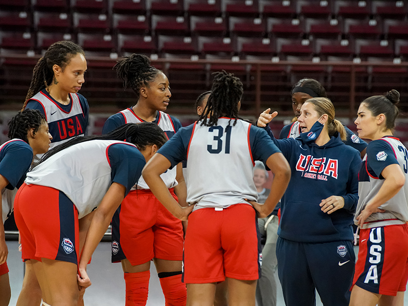 USA assistant coach Cheryl Reeve huddles up with members of the USA squad.