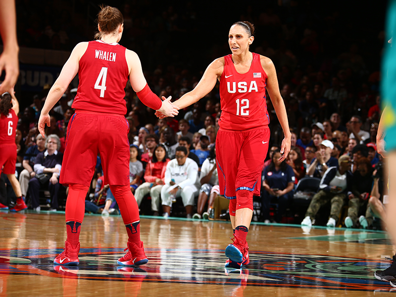 A little high five between guards Lindsay Whalen and Diana Taurasi.