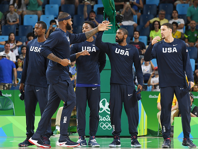 The USA team gives high fives during introductions.