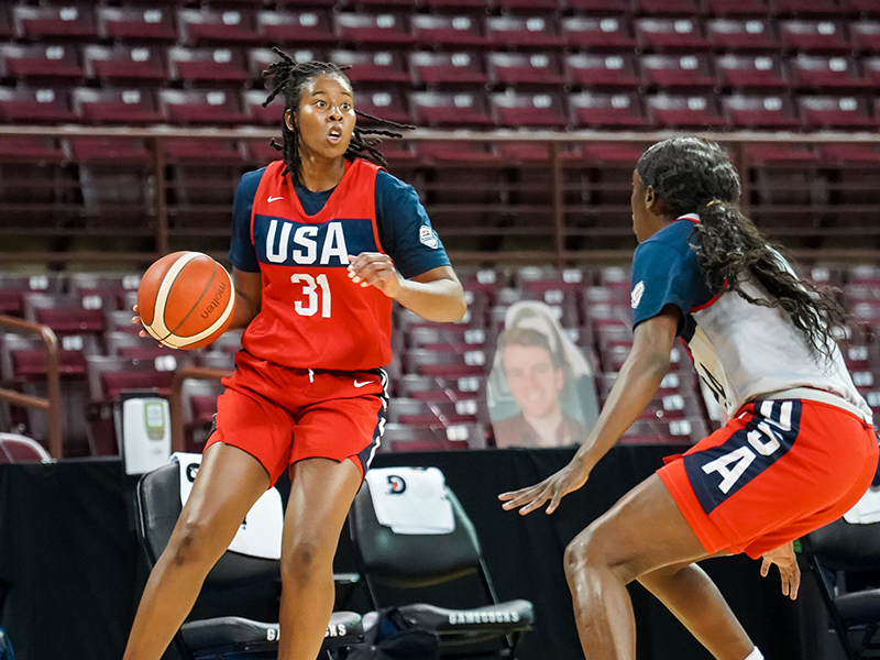 Ariel Atkins looks for a teammate.