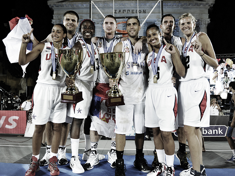 The gold medalist USA Basketball Women's 3x3 World Championship Team, featuring (L-R) Bria Hartley, Chiney Ogwumike, Skylar Diggins and Ann Strother, poses with the Serbian mens' squad, which also captured gold at the inaugural FIBA 3x3 World Cup in 2012.