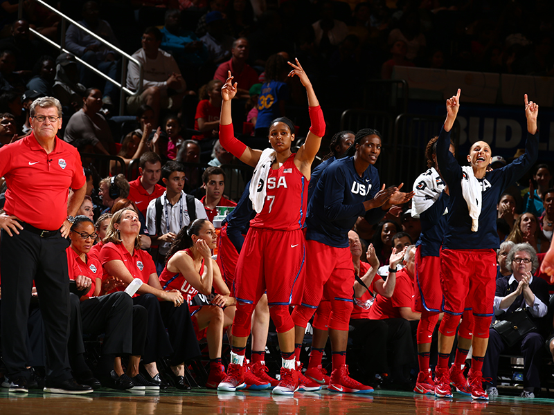 The USA's bench reacts to a 3-pointer.
