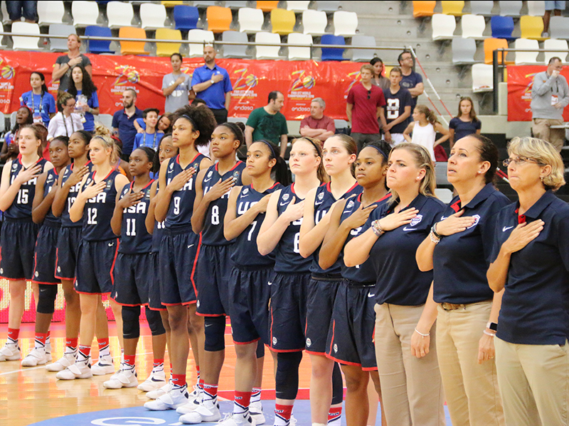 The USA Basketball Women's U17 World Championship Team stands at attention during the national anthem.