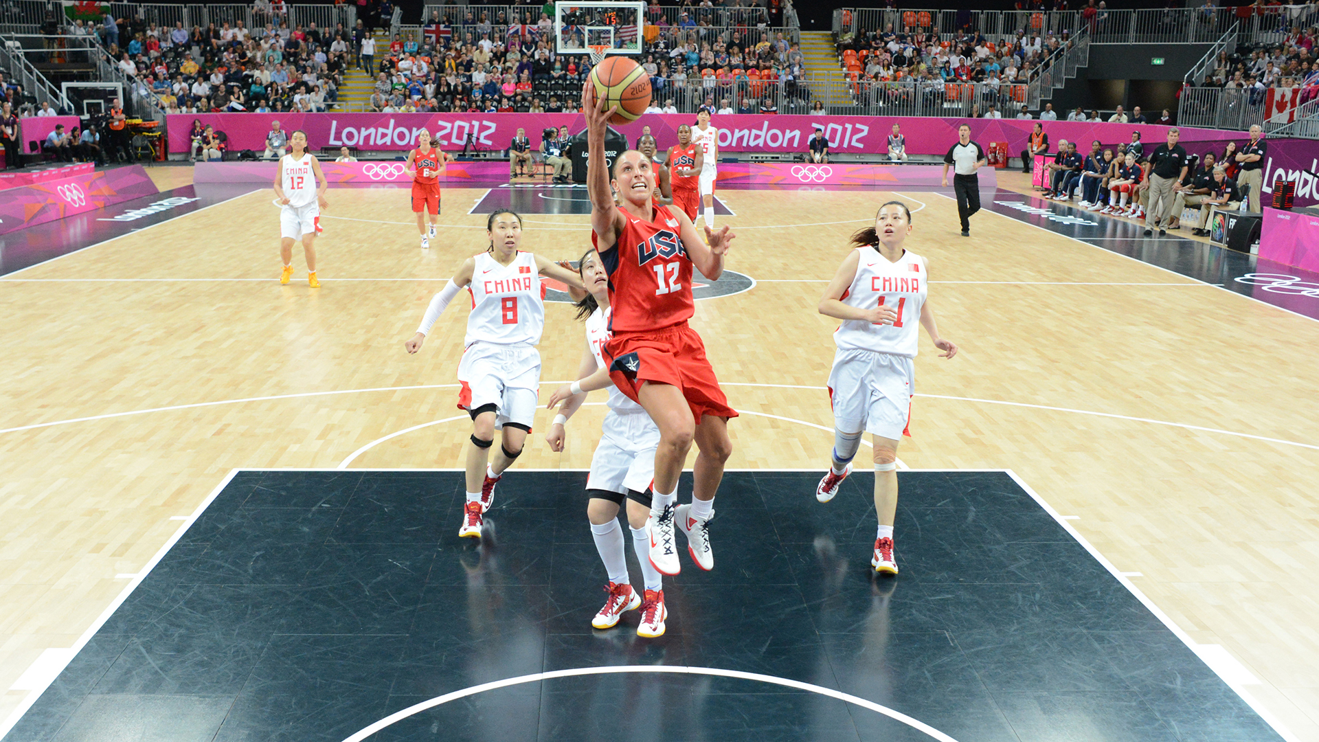 Diana Taurasi goes in for a layup versus China in the 2012 Olympics