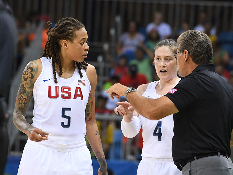 Seimone Augustus and Lindsay Whalen get some instruction from USA head coach Geno Auriemma.