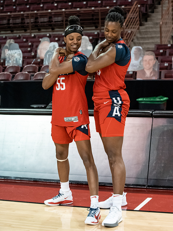 Showtime! Diamond DeShields (left) and Sylvia Fowles compare muscles.