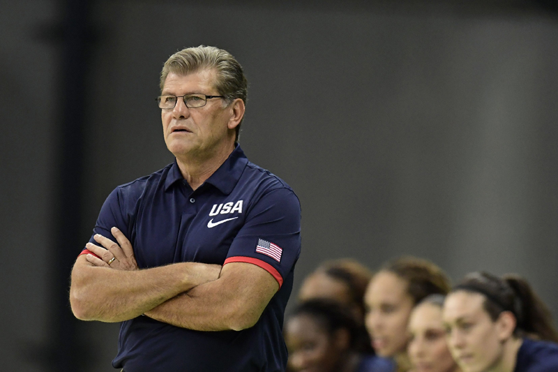 Head Coach Geno Auriemma looks on as his team delivers another winning performance.