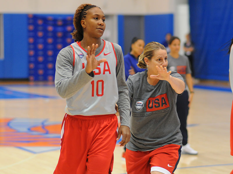 USA assistant coach Cheryl Reeve instructs Tamika Catchings