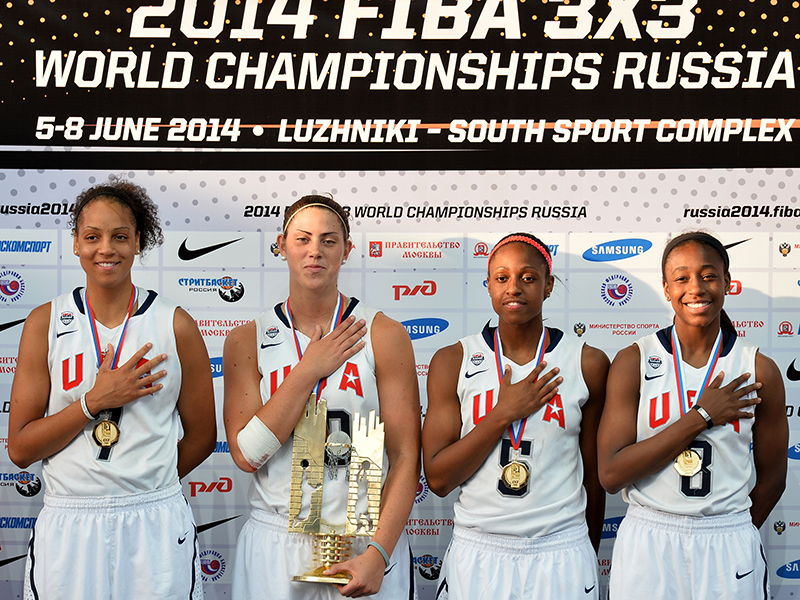 Members of the gold medal winning 2014 USA 3x3 World Championship Team, (L-R) Cierra Burdick, Sara Hammond, Tiffany Mitchell and Jewell Loyd, stand as the U.S. national anthem is played.