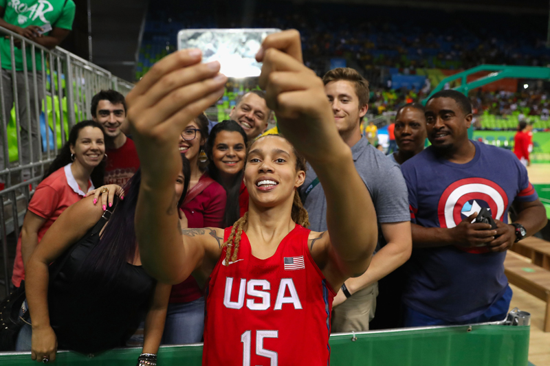Brittney Griner shows some love for the fans with a post-victory group selfie.