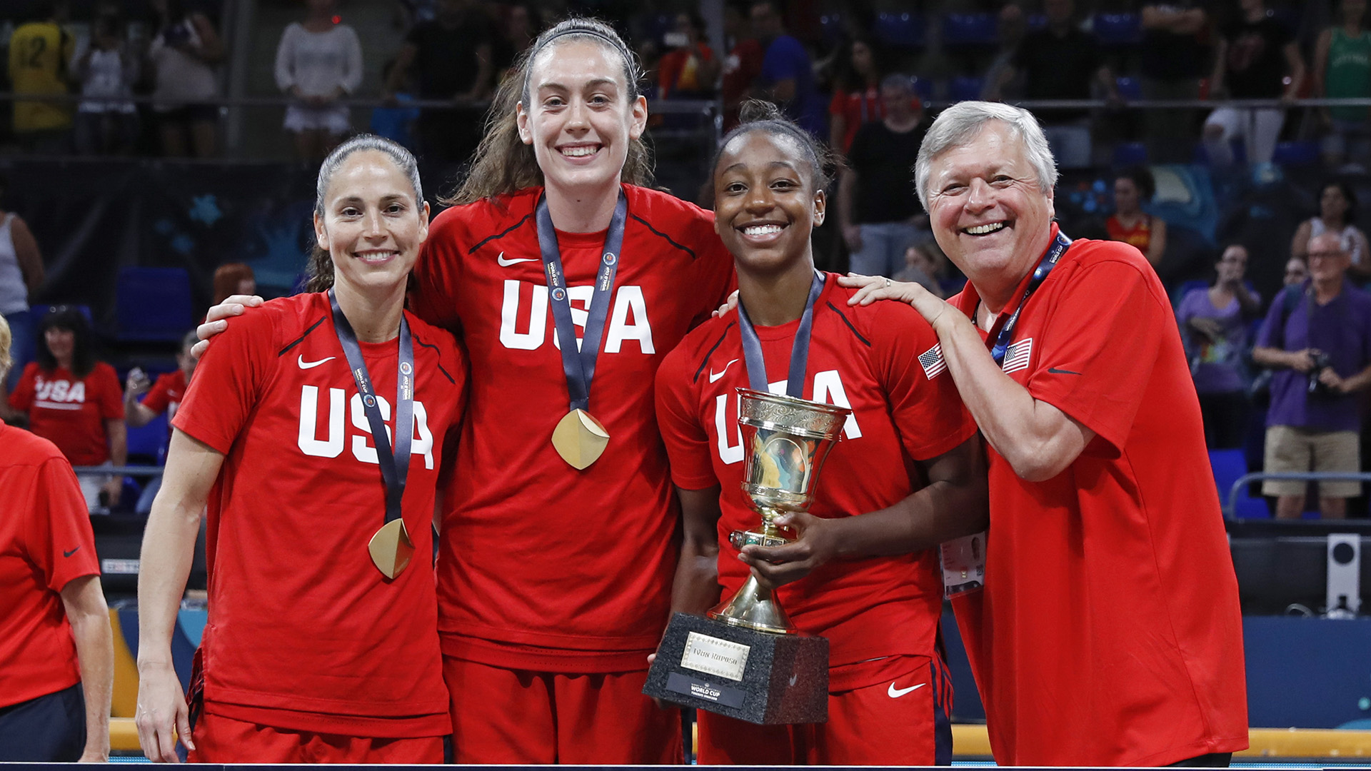 Sue Bird, Breanna Stewart, Jewell Loyd and Dan Hughes celebrate winning the 2018 FIBA World Cup gold medal.