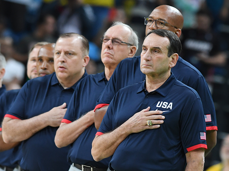 The USA coaching staff during the national anthem.