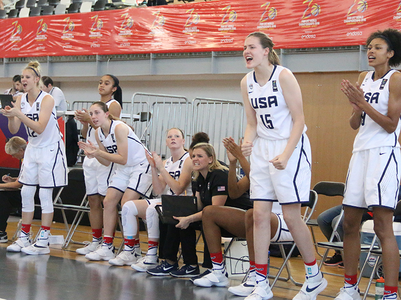 USA U17 World Championship Team members cheer on their teammates from the bench.