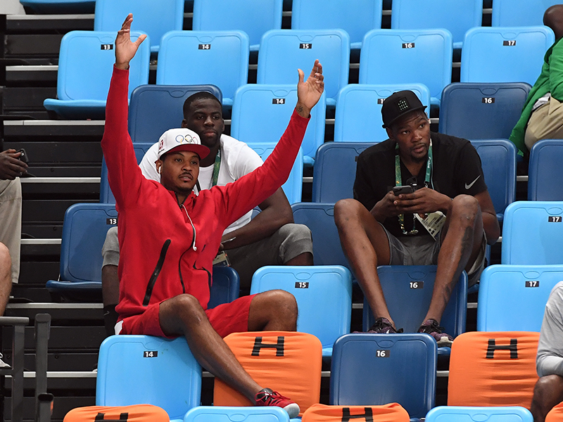 Carmelo Anthony and many of his teammates came out to support the women's team.