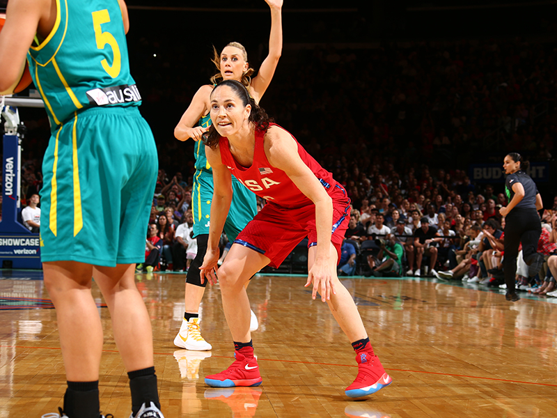 Sue Bird, who dished out six assists, gets into a low defensive stance.